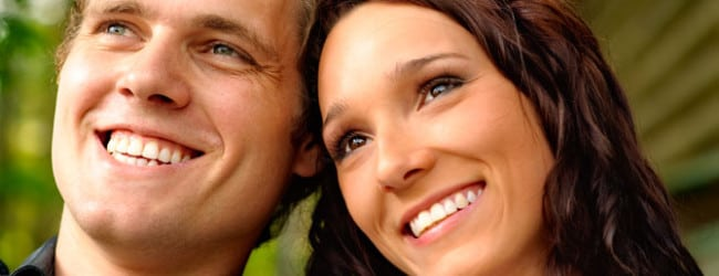 smiling couple with great teeth from their madison dentist