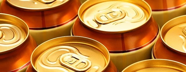 close-up photo of tops of soda cans
